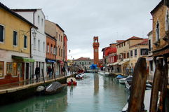 Murano canal and central street of Murano with shops and restaurants Stock Photos
