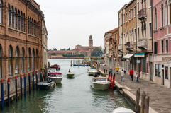 Murano canal with old building and people. Italy Stock Photos