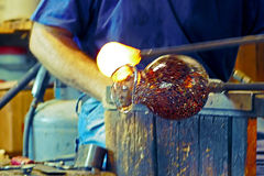 Murano glass artistic creation 2. Glass worker in action (public demonstration) in the Murano, Italy, glass factory on, August 5, 2015. Vintage processing Royalty Free Stock Images