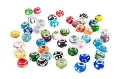 Murano glass beads scattering. On a white background Stock Images