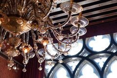 Murano glass chandelier against gothic window detail Stock Image