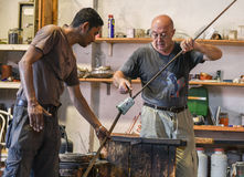 Murano Glass maker. Murano glass is glass made on the Venetian island of Murano, which has specialized in fancy glasswares for centuries. A traditional master Royalty Free Stock Image