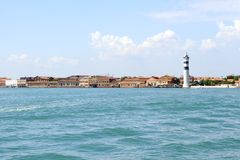 Murano island with lighthouse, view from sea. Horizontal royalty free stock photography