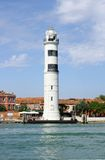 Murano island with lighthouse, view from sea. Vertical royalty free stock photo