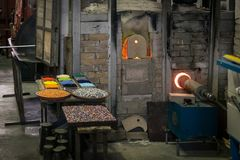 Interior of an artistic glassworks in Murano, Venice. Ancient furnace for blown glass processing. Murano, Italy - April 24, 2017: Interior of an artistic royalty free stock photos