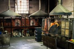 Interior of an artistic glassworks in Murano, Venice. Ancient furnace for blown glass processing. Murano, Italy - April 24, 2017: Interior of an artistic stock images