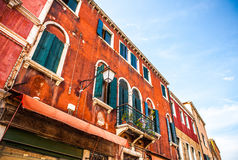 MURANO, ITALY - AUGUST 19, 2016: Famous architectural monuments and colorful facades of old medieval buildings close-up. On August 19, 2016 in Murano, Italy Royalty Free Stock Images