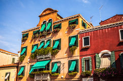 MURANO, ITALY - AUGUST 19, 2016: Famous architectural monuments and colorful facades of old medieval buildings close-up. On August 19, 2016 in Murano, Italy Stock Photo