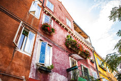 MURANO, ITALY - AUGUST 19, 2016: Famous architectural monuments and colorful facades of old medieval buildings close-up. On August 19, 2016 in Murano, Italy Stock Image