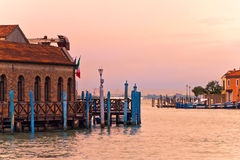 Murano in Venice. Buildings and docks on Murano island in Venetian Lagoon during the sunset, Venice, Italy Royalty Free Stock Photos