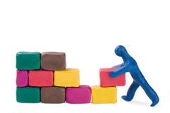 Muratore e muro di mattoni Fotografia Stock