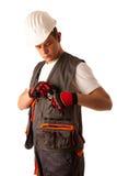 Muratore in vestito dal lavoro isolato sopra fondo bianco fotografia stock