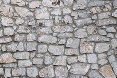 Muratura di pietra medievale antica Struttura di un frammento di una parete di vecchia struttura Un fondo per progettazione e lav fotografie stock