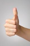 Murbruk på den kvinnliga tummen Royaltyfri Bild