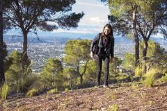 Murcia, Spain - April 9, 2019: cheerful young woman hiking and taking pictures with her reflex stock image