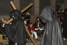 Murcia, Spain, April 19, 2019: Night procession of silence during the Holy Week on the Murcia streets royalty free stock photo