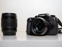 Murcia, Spain; August 24 2018: Panasonic Lumix G DMC-80M G85 with Panasonic Leica 15mm 1:1.7 DG ASPH Summilux isolated in white ba royalty free stock photography
