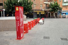 Murcia, Spain - August 4 2018: Public bicycles of the University of Murcia, on the PLAZA del la UNIVERSIDAD, locked and ready to b. E hired or rented by members stock photo