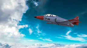 Modern military jet fighter airplane flying above the clouds royalty free stock photos