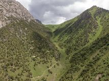 Murdash Village Alay Valley Kyrgyzstan Osh Region. A View of Alay Valley, Trans-alay Range, and Kyzyl-suu West River. Alay Moun stock photo