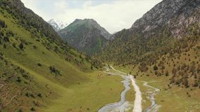 Murdash Village Alay Valley Kyrgyzstan Osh Region. A View of Alay Valley, Trans-alay Range, and Kyzyl-suu West River. Alay Moun stock footage
