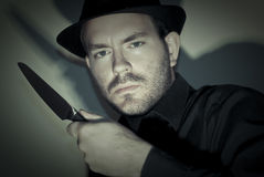 Murder. With knife and hat at night stock photo