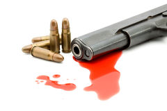 Murder concept - gun and blood. Studio isolated Royalty Free Stock Image