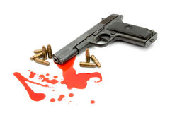 Murder concept - gun and blood. Studio isolated Royalty Free Stock Photo