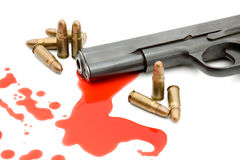Murder concept - gun and blood. Studio isolated stock image