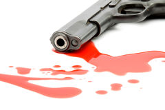 Murder concept - gun and blood. Studio isolated Royalty Free Stock Images