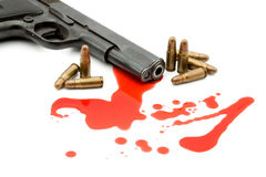Murder concept - gun and blood. Studio isolated Royalty Free Stock Photography