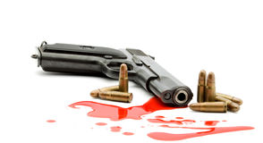 Murder concept - gun and blood Royalty Free Stock Photography