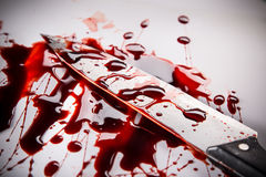 Murder concept - knife with blood on white background Royalty Free Stock Photo