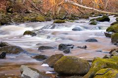 Murder Creek. Rapids, flowing over moss covered rocks, at Akron Falls Park stock photos