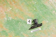 Murder gun lying on the floor. crime scene Stock Photography