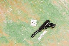 Murder gun lying on the floor. crime scene Stock Photos