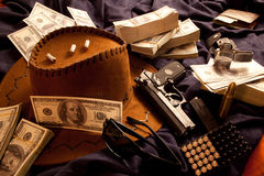 Murder. Tools crime, gun and money to gangster cowboy