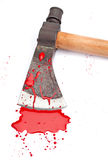 The Murder Weapon. A close-up of a bloody axe and small pool of blood (red paint) isolated on white Stock Photos