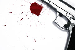 Murder Weapon. Illustrative styled photograph of a hand gun and blood splatter, on a white background Stock Image