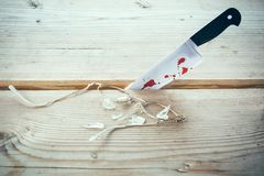 Murder weapon knife. A knife with blood and a broken glasses on a table Royalty Free Stock Photos
