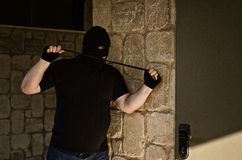 Murderer ambushing with rubber noose Stock Image