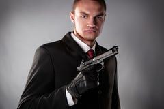 Murderer in black suit Stock Photo