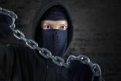 Murderer holding chain Royalty Free Stock Photos