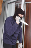 Murderer at home Stock Photo