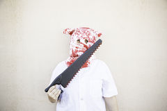Murderer with hooded Saw Stock Image