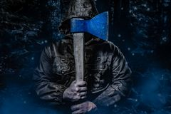 Free Murderer With An Axe In Dark Woods Royalty Free Stock Photos - 160792518