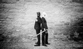 Murderers with masks. And weapons, fear and violence stock photography