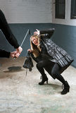 Murdering. Woman being attacked by a criminal with a crowbar royalty free stock photos