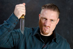 Murderous rage. Man with a knife in a murderous rage Royalty Free Stock Photography