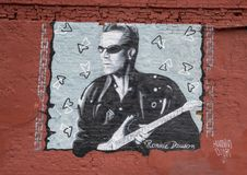 Mure a arte que caracteriza Ronnie Dawson em Ellum profundo, Dallas, Texas imagens de stock